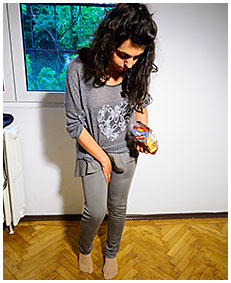sexy sara pisses brown leggings while eating snacks 03