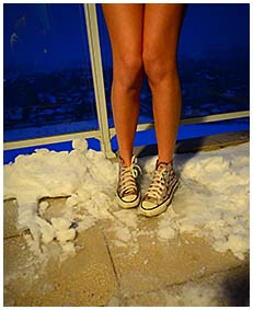 Beatrice wets her jeans overalls on the balcony in snow