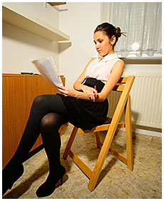 Beatrice is wetting her pantyhose working at her desk