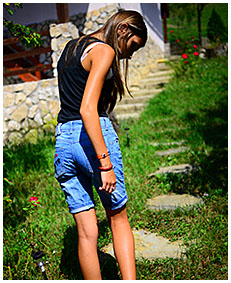 sexy teen pisses her jeans shorts climbing a fence wetting herself pissing her pants 02