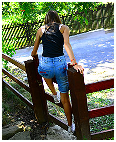 sexy teen pisses her jeans shorts climbing a fence wetting herself pissing her pants 04
