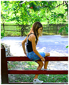 sexy teen pisses her jeans shorts climbing a fence wetting herself pissing her pants 05