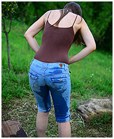 Claudia wets her tight jeans shorts and bodysuit watching the sunset