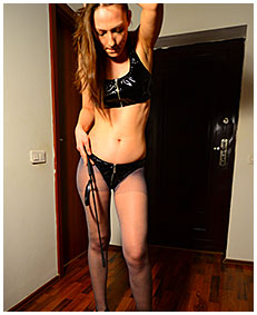 claudia mistress show pisses her dominatrix outfit 02