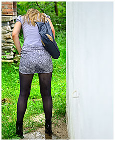claudia takes a big piss in her skirt and pantyhose wetting herself accidental 01