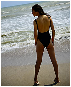 debbie pisses her swimsuit on the beach swim suit pee wetting swimsuits 04