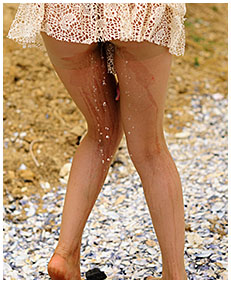 sexy girl pisses her dress on the beach wetting herself peeing 01