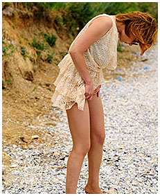 sexy girl pisses her dress on the beach wetting herself peeing 03