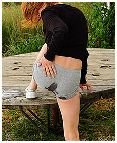sexy girl wets her shorts on the table pissing cold 03