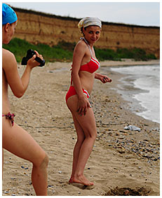 bathing suit accident wetting on the beach sand 02