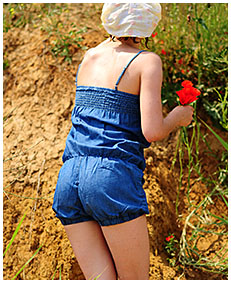 alice pees her denim overalls picking flowers 04