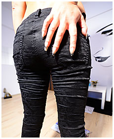 Erica soakes her black jeans