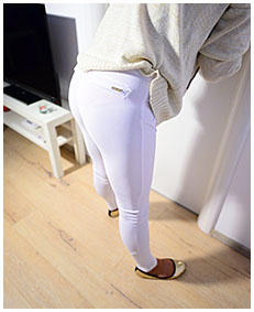 erica bound to door wets herself pissing in white leggings 02
