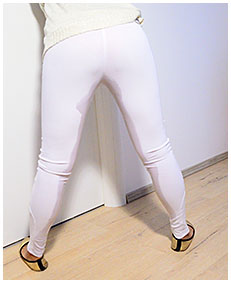 erica bound to door wets herself pissing in white leggings 03