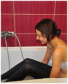 natalie wets pantyhose in the bathroom pissing herself in her panties02