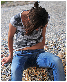 beach desperation natalie wets her blue jeans on the beach pissing herself 03