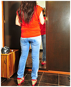 sexy girl pisses herself wetting her jeans in the mirror 01