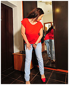 sexy girl pisses herself wetting her jeans in the mirror 05