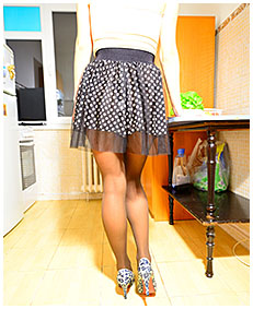Desperate to pee Antonia wets her skirt and pantyhose