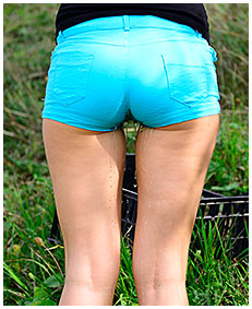 hot sexy girl wets shorts in the grass 03