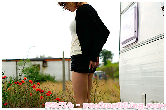 Alice wets herself outside the caravan, pee accident