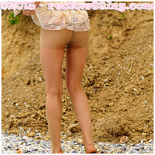 Sexy girl pisses herself on the beach wetting her panties