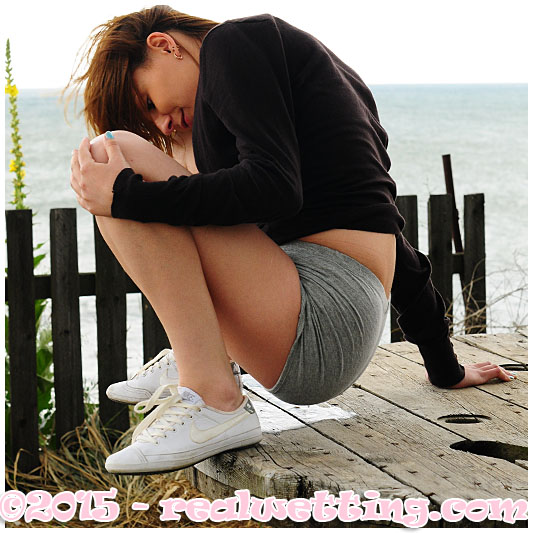 Girl wetting her shorts cold weather waiting pissing her pants peeing her panties