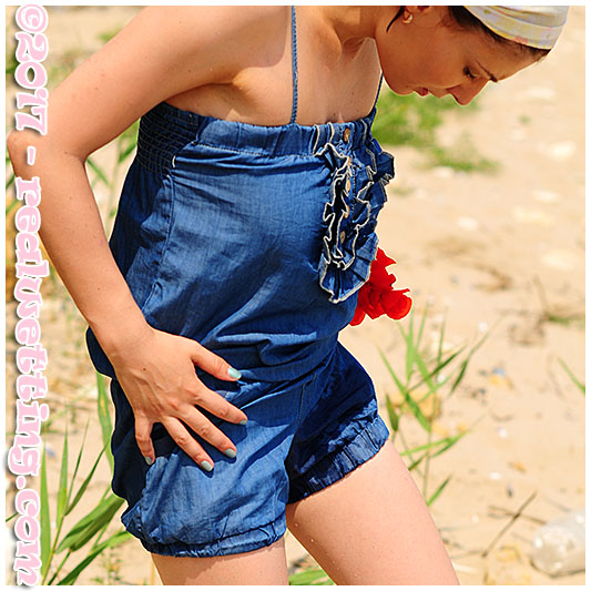 Alice picks flowers and wets her denim overalls