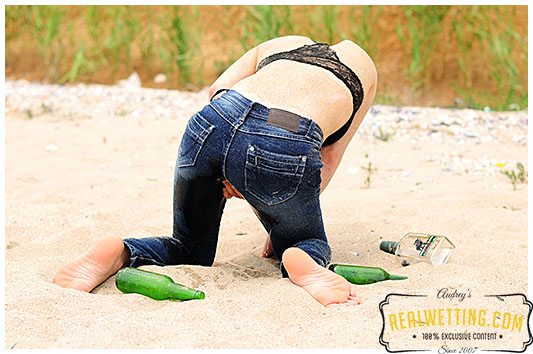 Too drunk to take a piss Alice goes into her tight jeans on the beach