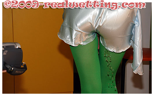 alice pisses in her green tights whilst her boyfriend is at the door