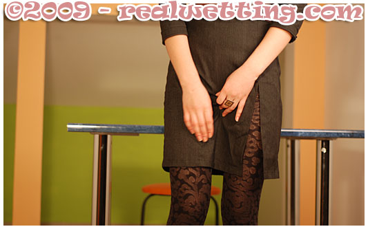 alice pisses herself at an interview urinating in her pantyhose