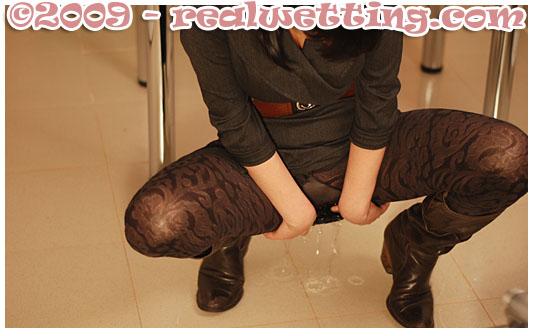 hot girl pisses herself at the office wetting her pantyhose nylons
