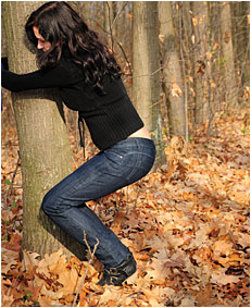 antonia pees her jeans tied to a tree wetting her jeans 04