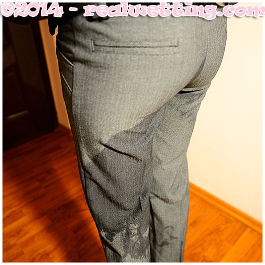 Antonia pisses herself wetting her business suit pantyhose and gray tight ass pants urinating in her clothing