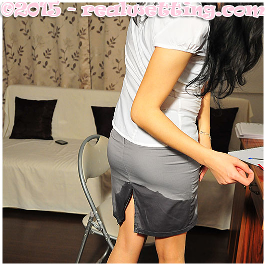 Wetting pantyhose and skirt accident peeing at the office