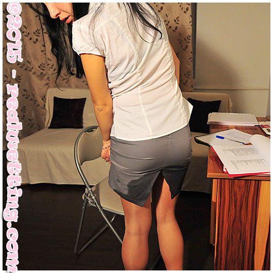 Sexy girl wetting her pantyhose skirt office piss