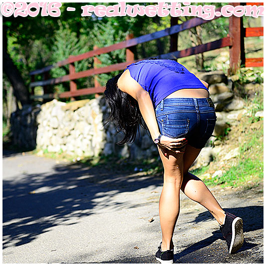 Antonia makes a mess in her jeans shorts on the street
