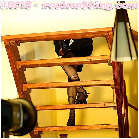 Antonia goes peeing into her pantyhose on the stairs