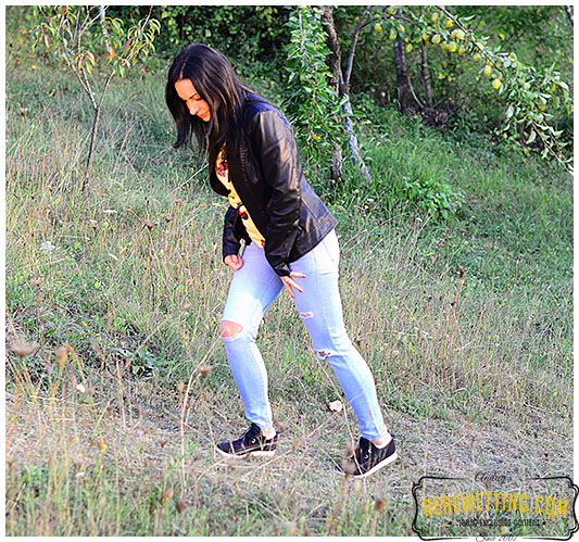 Young girl wets her jeans walking up the trail jeans