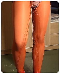 audrey has an accident pissing her orange pantyhose wetting herself