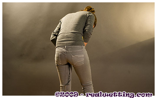 Audrey pissing herself in tight grey jeans and wearing pantyhose peeing herself on purpose
