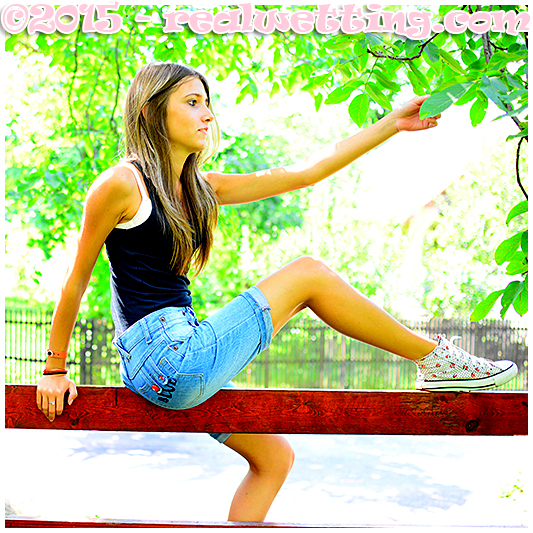 beatrice wets her jeans shorts climbing a fence