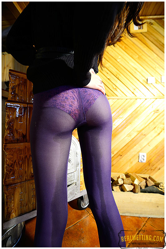 Beatrice feeds the fireplace in purple pantyhose