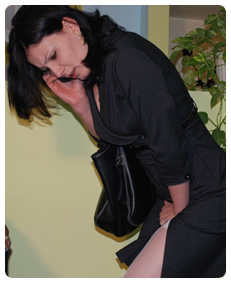 business woman pissing her pantyhose nylons and business suit pee urination accident wetting herself