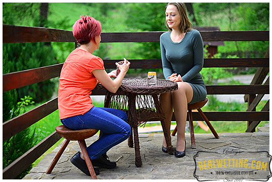 Two girls play the wetting card game 1