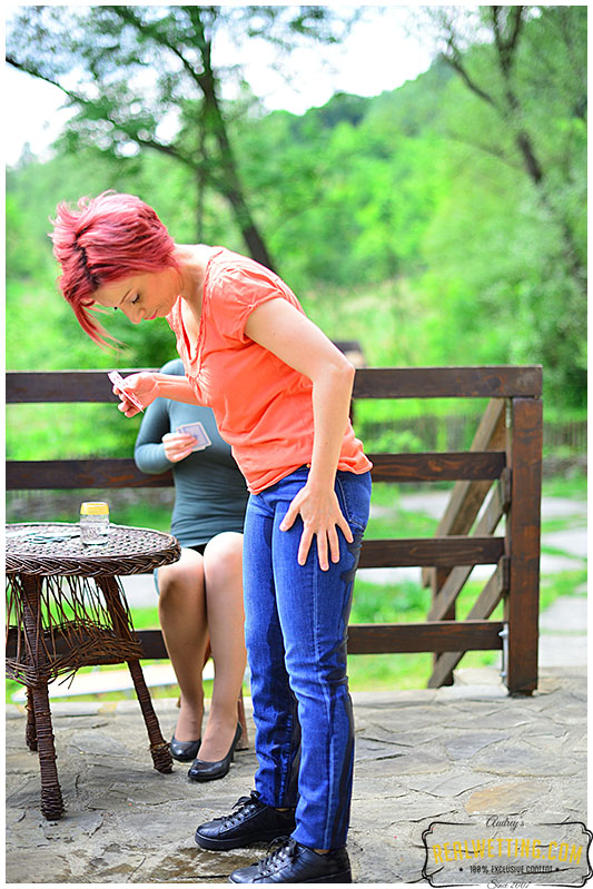 Two girls play the wetting card game 0