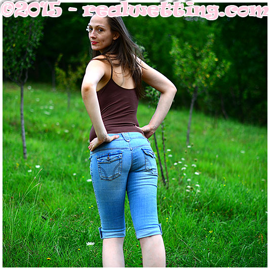 Claudia wets her jeans shorts and body suit in jeans wetting