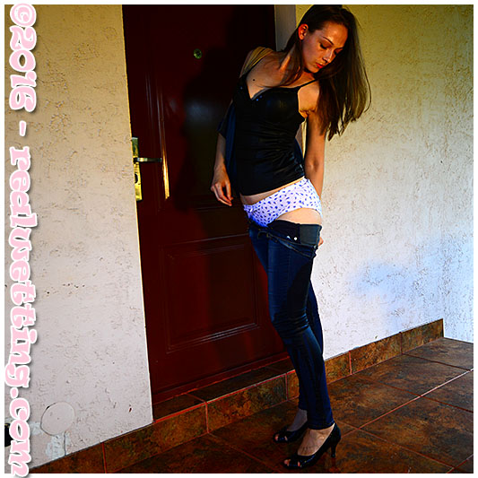 Looking for her house keys in the huge hand bag she was carrying, Claudia`s jeans get a little wet in the progress