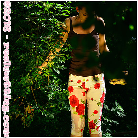Claudia wets her flowery pants in the orchard