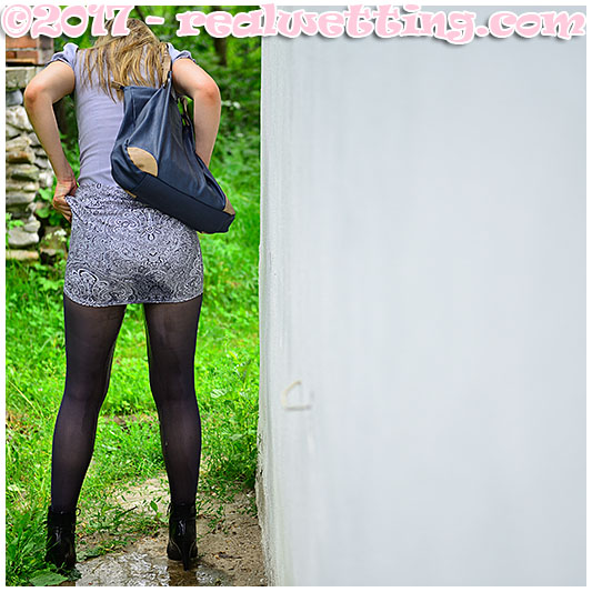 Claudia takes a big piss into her pantyhose pissing her boots and skirt